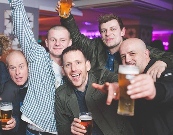 Stag party holding up pints of beer in Garavogue bar Sligo