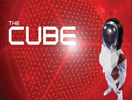 Man dressed in white outfit with helmit ready for The Cube Experience