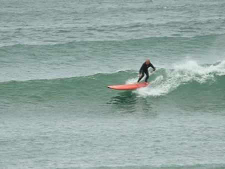 Surfing catching wave in Sligo